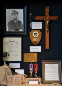 The Rev. Aloysius Schmitt's chalice, prayer book, military medals and more of his personal belongings recovered in the ship's wreckage are on display in the entrance of Christ the King Chapel at Loras College. The chapel was built between 1946-47 as a memorial to Schmitt.
