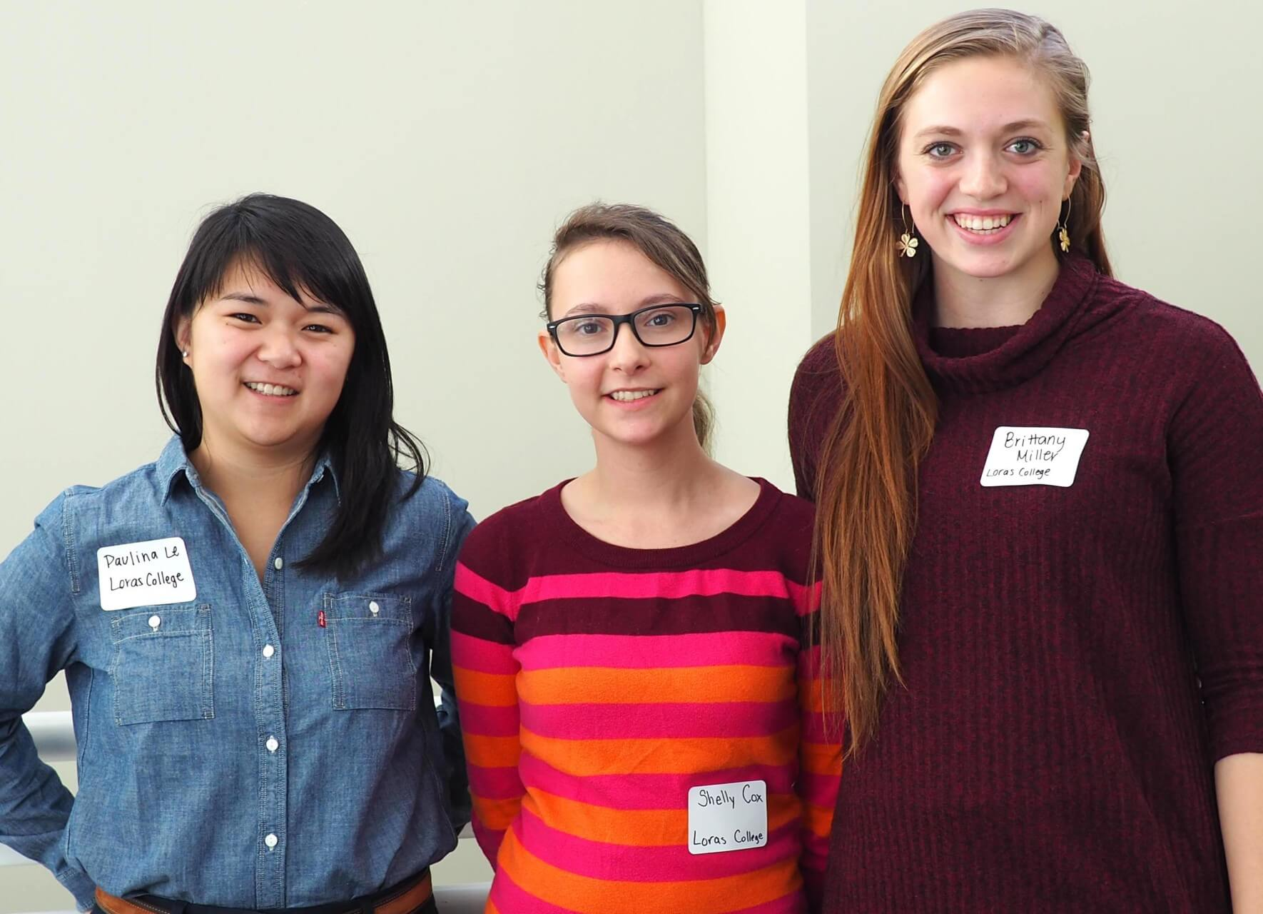 Loras College seniors Paulina Le (left) Sherrill, Iowa; Shelly Cox (center), Youngtown, Arizona; and Brittany Miller (right), Clear Lake, Iowa, received honorable mention at the recent 2016 MinneMUDAC Analytics Competition.